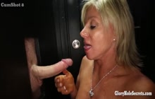 Sexy MILF sucking cocks on gloryhole